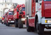 Fire trucks in carnival procession — Stock Photo