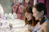 Women chooses jewelry — Stock Photo