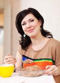 Woman eats buckwheat — Stock Photo