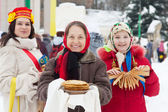 Women with pancake during Pancake Week — Stock Photo