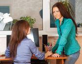 Two women in office — Stock Photo