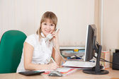 Businesswoman in office speaking by phone — Stock Photo