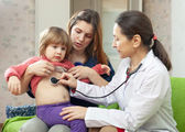 Pediatrician doctor examining baby with stethoscope — Stock Photo