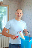 Man with paint roller — Stock Photo