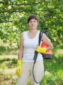 Woman with garden spray — Stock Photo