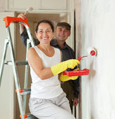 Mature woman and man making repairs — Stock Photo