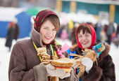 Girls with pancake during Shrovetide — Stock Photo