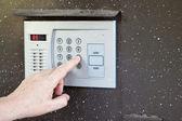 Uses intercom in steel door — Stock Photo