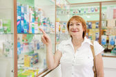Mature woman at the pharmacy — Stock Photo