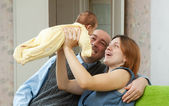 Happy parents with newborn baby — Stock Photo