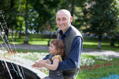 Happy father plays with child in park — Stock Photo