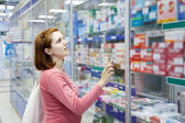 Woman in pharmacy drugstore — Foto Stock