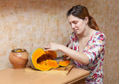 Young woman cooking pumpkin — Stock Photo