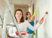 Two women paints wall — Stock Photo