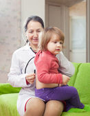 Doctor examining baby with stethoscope — Stock Photo