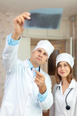 Friendly doctors looking x-ray — Stock Photo