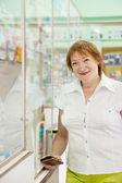 Mature woman in pharmacy drugstore — Stock Photo