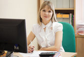 Businesswoman working in office room — Stock Photo