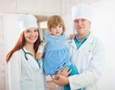 Doctors with baby girl in the clinic — Stock Photo