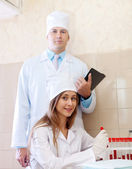 Nurse and male doctor in clinic lab — Stock Photo