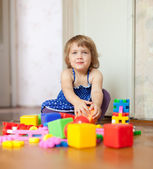 Girl plays with toys in home — Stock Photo