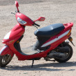 Red new scooter on road from summer — Stock Photo #2249934