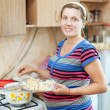 Pregnant woman cooking dumplings — Foto Stock