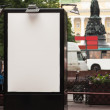 Blank billboard on city street - Stock Photo