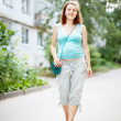 Pregnant woman walking on street — Foto Stock