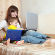 Happy mother and child with laptops — Stockfoto