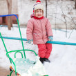 Child with sled  in winter park — 图库照片