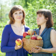 Stock Photo: Girls with apples harvest