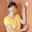 Woman turning off the light-switch — Stock Photo #23476527