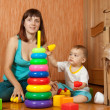 Mother and baby plays with toys — Stock Photo #23476575