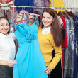 Stock Photo: Women chooses blue evening gown