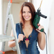 Sexy girl with drill and electrical cable — Stock Photo