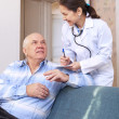 Doctor asked male mature patient feels — Stock Photo