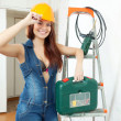 Happy sexual girl in hardhat  with tools — Foto Stock