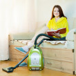 Woman reposes from household chores — Stockfoto