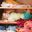 Baby girl is in the closet — Stock Photo