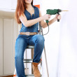 Woman makes repairs in home — Stock Photo