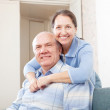 Cheerful mature couple in home  — Stock Photo