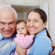 Foto Stock: Mature couple with little baby