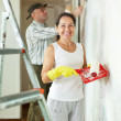 woman and man makes repairs in  interior  — Stock Photo