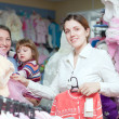 Women of three generations  at clothes store - Stock Photo