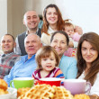 Large happy family having tea   — Stock Photo