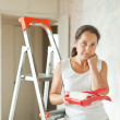 Wommakes repairs at home — Stock Photo #23477699