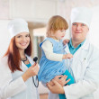 Friendly doctors with child   — Stock Photo #23477737