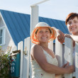 Stock Photo: Two happy women near fence wicket