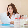 Clinician working in laboratory — Stock Photo